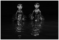 Water puppets (2 characters with fans), Thang Long Theatre. Hanoi, Vietnam (black and white)