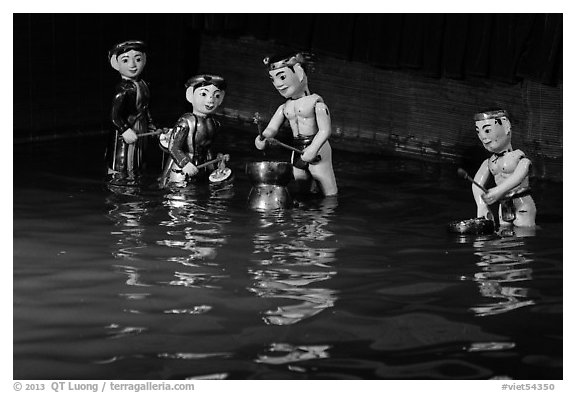 Water puppets (4 characters with musical instruments), Thang Long Theatre. Hanoi, Vietnam (black and white)