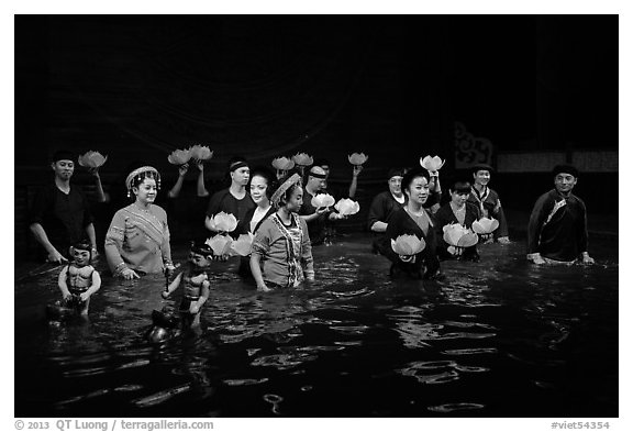 Water puppet artists standing in pool after performance, Thang Long Theatre. Hanoi, Vietnam (black and white)