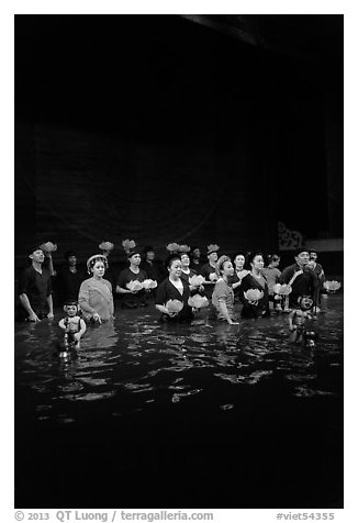 Water puppet artists receiving applause in pool after performance, Thang Long Theatre. Hanoi, Vietnam (black and white)