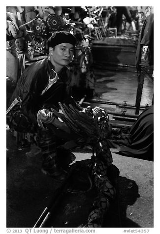 Water puppet artist holding dragon backstage, Thang Long Theatre. Hanoi, Vietnam (black and white)
