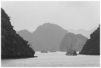 Tour boats and islands in mist. Halong Bay, Vietnam (black and white)