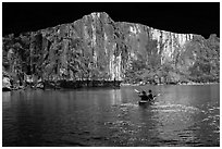 Kayaking out of Luon Cave. Halong Bay, Vietnam ( black and white)