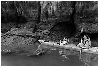 Sea kayakers approaching monkey. Halong Bay, Vietnam ( black and white)
