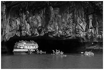 Kayaks floating through Luon Can tunnel. Halong Bay, Vietnam (black and white)