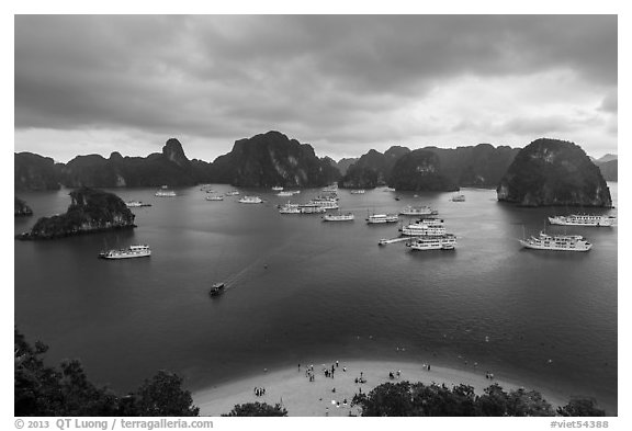 Crescent beach, boats and karst, Titov Island. Halong Bay, Vietnam (black and white)