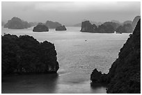 Elevated view of monolithic islands from above, evening. Halong Bay, Vietnam (black and white)