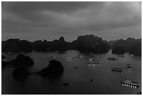 Tour boats lights and islands from above at night. Halong Bay, Vietnam (black and white)