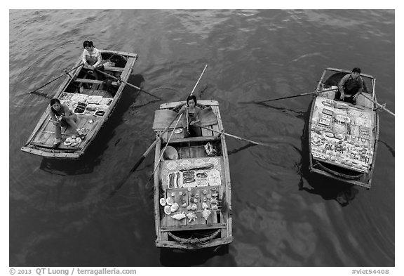 Women selling sea shells and perls from row boats. Halong Bay, Vietnam (black and white)