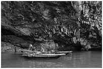 Fishermen anchor in cave for breakfast. Halong Bay, Vietnam ( black and white)