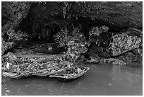 Fishermen anchor eating breakfast in cave. Halong Bay, Vietnam (black and white)