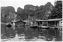 Vung Vieng village below karstic islands,. Halong Bay, Vietnam (black and white)