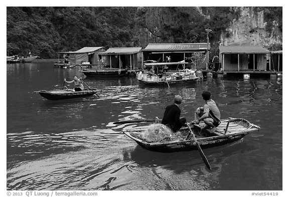 Villagers and houses, Vung Vieng fishing village. Halong Bay, Vietnam (black and white)