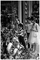 Children checkout ceramic store. Bat Trang, Vietnam (black and white)