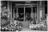 Ceramic store front with vases of all sizes. Bat Trang, Vietnam (black and white)