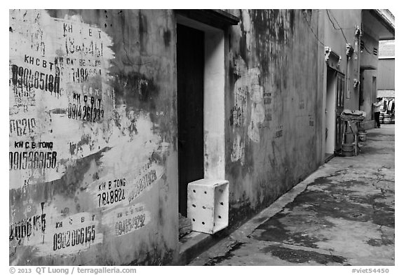 Alley with lots of painted numbers. Bat Trang, Vietnam (black and white)