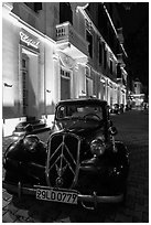 Vintage car in front of Metropole hotel at night. Hanoi, Vietnam (black and white)