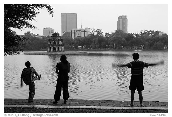 People exercising in front of Turtle Tower, Hoang Kiem Lake. Hanoi, Vietnam (black and white)