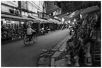 Street with flower sellers in early morning, old quarter. Hanoi, Vietnam (black and white)