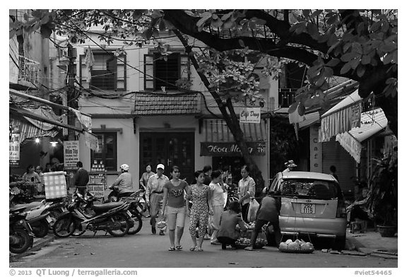 Early morning food shopping, old quarter. Hanoi, Vietnam (black and white)