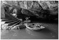 Man readyning a boat inside cave, Trang An. Ninh Binh,  Vietnam (black and white)