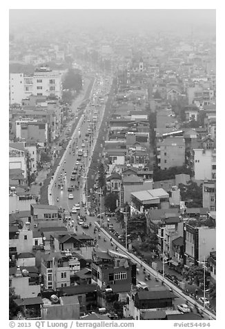 Expressway and buildings in mist seen from above. Hanoi, Vietnam (black and white)