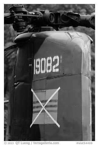 Helicopter tail with crossed-out flag of South Vietnam, Hanoi Citadel. Hanoi, Vietnam (black and white)