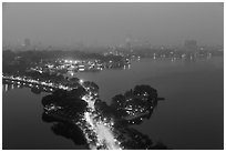 West Lake and city skyline from above by night. Hanoi, Vietnam (black and white)