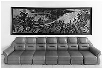 Propaganda painting and couch, military museum. Hanoi, Vietnam (black and white)