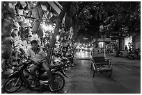 Street at night with motorcycle and cyclo, old quarter. Hanoi, Vietnam (black and white)