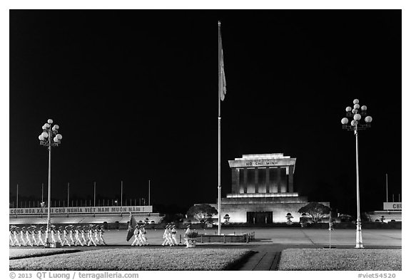 Guards marching in front of Ho Chi Minh Mausoleum at night. Hanoi, Vietnam (black and white)