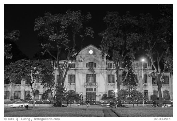 Colonial-area buildings bordering Ba Dinh Square at night. Hanoi, Vietnam (black and white)