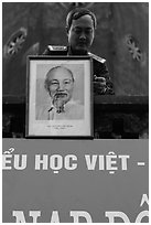Officer hanging a picture of Ho Chi Minh, Hanoi Citadel. Hanoi, Vietnam (black and white)