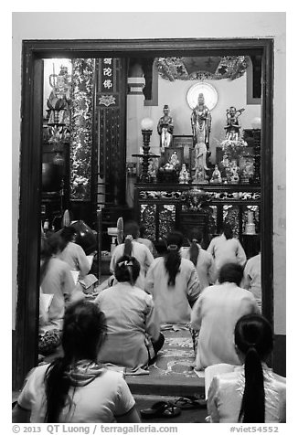 Women worshipping in Phung Son Pagoda, district 11. Ho Chi Minh City, Vietnam (black and white)