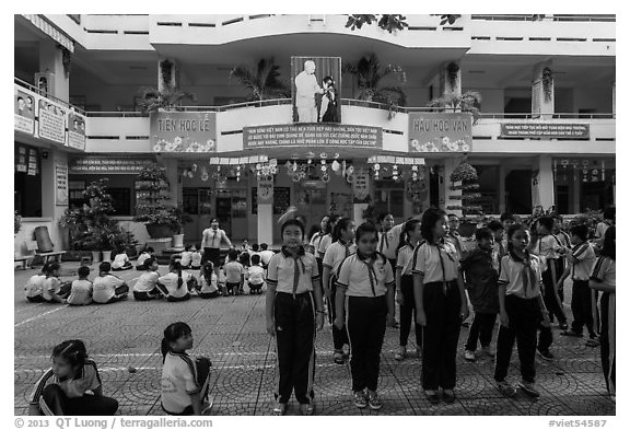 Schoolchildren in school courtyard, district 5. Ho Chi Minh City, Vietnam (black and white)