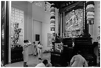 Women worshipping, An Quang Pagoda, district 10. Ho Chi Minh City, Vietnam (black and white)