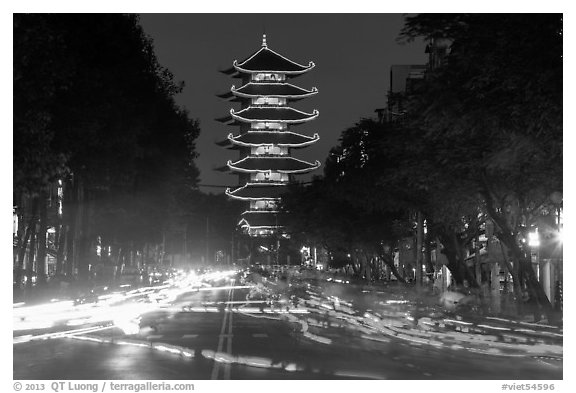 Traffic at night and Quoc Tu Pagoda, district 10. Ho Chi Minh City, Vietnam (black and white)