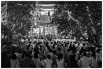 Worshippers at Quoc Tu Pagoda by night, district 10. Ho Chi Minh City, Vietnam (black and white)