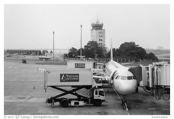 Airliner and control tower, Tan Son Nhat airport, Tan Binh district. Ho Chi Minh City, Vietnam (black and white)