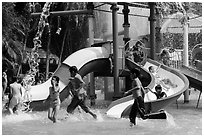 Children playing, Dam Sen Water Park, district 11. Ho Chi Minh City, Vietnam ( black and white)