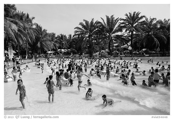 Pool with artificial waves, Dam Sen Water Park, district 11. Ho Chi Minh City, Vietnam (black and white)
