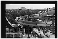 Water slides and skylines, Dam Sen Water Park, district 11. Ho Chi Minh City, Vietnam (black and white)