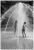 Children in fountain, Dam Sen Water Park, district 11. Ho Chi Minh City, Vietnam ( black and white)