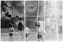 Group playing in water, Dam Sen Water Park, district 11. Ho Chi Minh City, Vietnam (black and white)