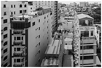 Rooftop view of skinny hotel buildings. Ho Chi Minh City, Vietnam (black and white)