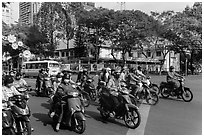 Motorbike riders waiting at intersection. Ho Chi Minh City, Vietnam (black and white)