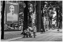 Family chatting with vendor in park. Ho Chi Minh City, Vietnam (black and white)