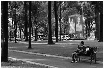 Relaxing on a public bench in April 30 Park. Ho Chi Minh City, Vietnam ( black and white)