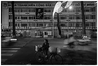 Vendor with bicycle at night. Ho Chi Minh City, Vietnam ( black and white)