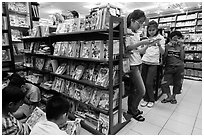 Bookstore shelves and children reading. Ho Chi Minh City, Vietnam (black and white)